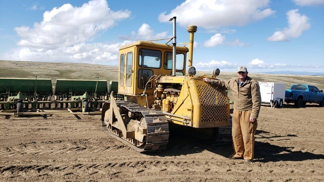Dale Padget with the Cat tractor