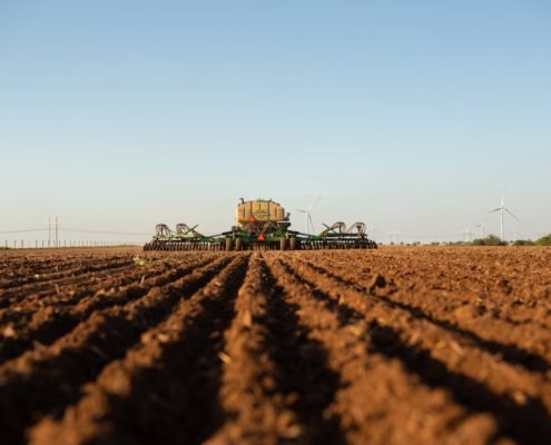 Tractor and equipment planting wheat
